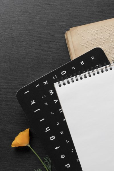 Notepad, braille book and braille keyboard