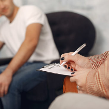 Man sitting in the psychologist's office and talking